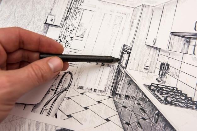 Il designer dipinge uno schizzo moderno dell'appartamento. design per la casa. vista dall'alto