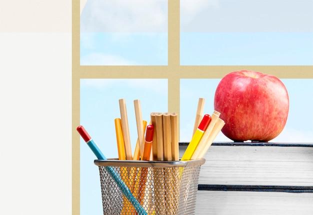 Scrivania con libro e cancelleria con uno sfondo di vetro della finestra. ritorno al concetto di scuola