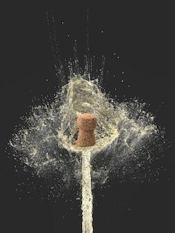 Dettaglio dell'esplosione di un tappo di sughero di una bottiglia di champagne.