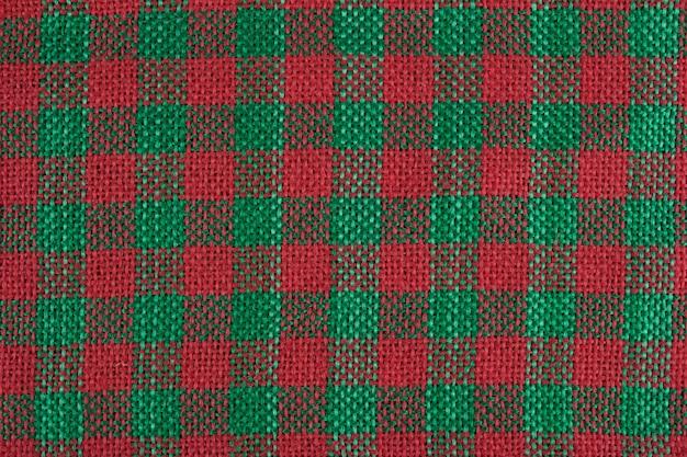 Dettaglio della trama di iuta rossa e verde.