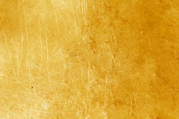 Dettagli della priorità bassa astratta di struttura dell'oro.