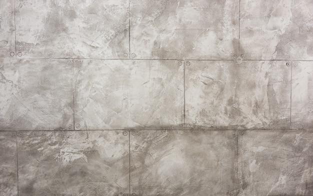 Particolari di una parete interna realizzata con lastre di beton
