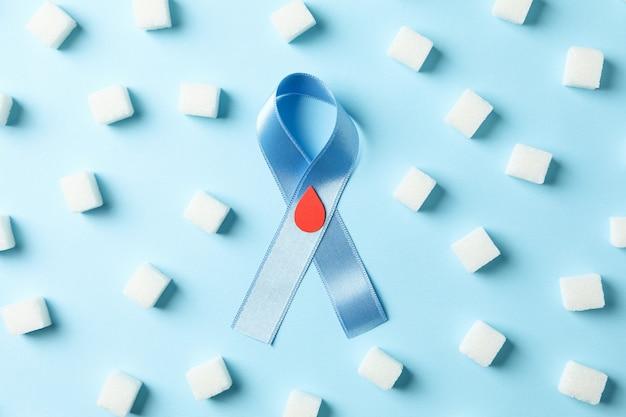 Nastro di consapevolezza del diabete e zollette di zucchero