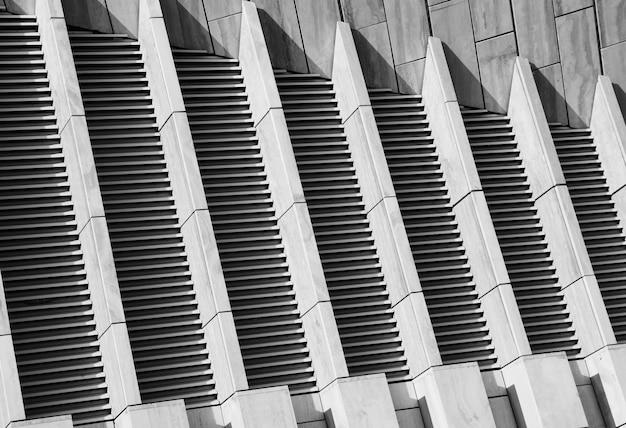 Fondo diagonale di struttura del muro di cemento in bianco e nero hd