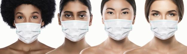 Donne di etnia diversa che indossano una maschera facciale per la protezione della nuova malattia da coronavirus. concetto di problema mondiale con il covid-19.