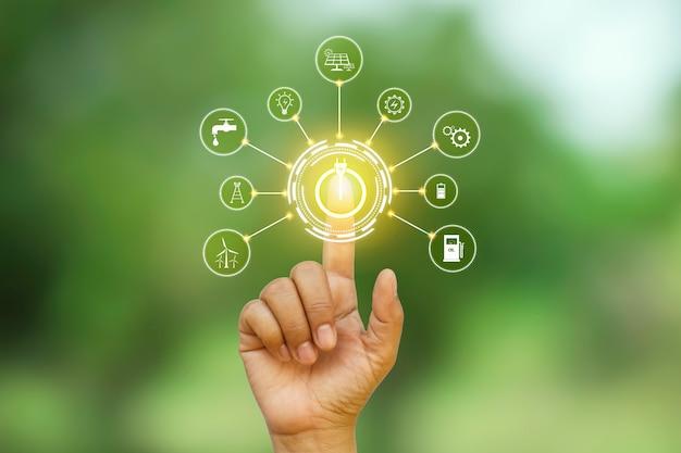 Design digitale di un pulsante di accensione premuto da una mano e circondato da più icone.