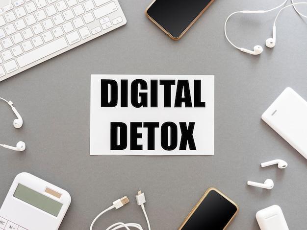 Testo di disintossicazione digitale incorniciato con gadget it