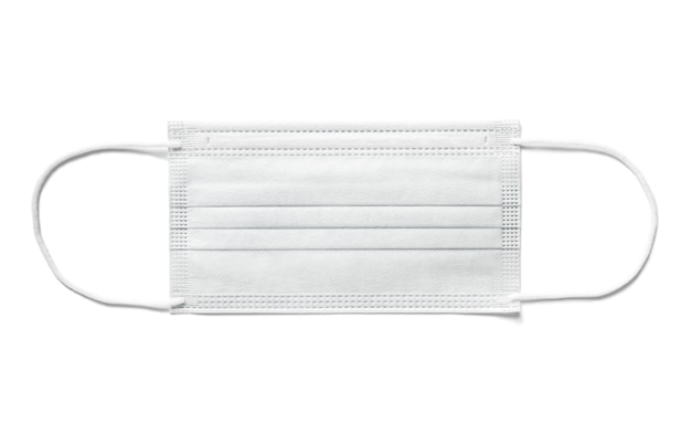 Mascherina chirurgica monouso isolata su priorità bassa bianca. protezione dal covid19