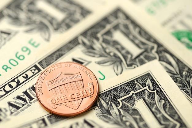 Banconote da un dollaro e penny