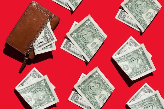 Banconote da un dollaro e portafoglio su uno sfondo luminoso concetto di denaro ed economia