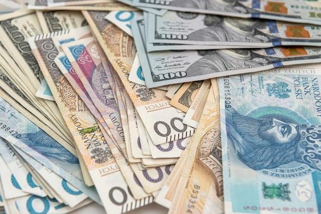 Dollari e zloty polacchi pln come concetto di sfondo di finanza aziendale