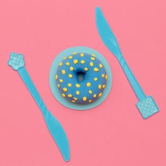 Amante della ciambella. disposizione piatta. dolce caramella minimal art