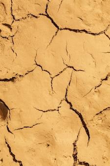 Fondo incrinato secco di struttura del suolo del suolo della terra