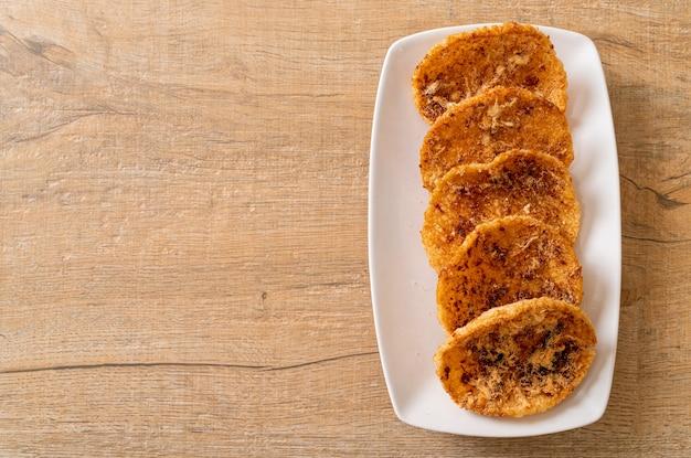Cracker di riso secchi di maiale grattugiato - stile alimentare tailandese