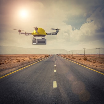 Il drone per le spedizioni vola sopra una strada isolata in mezzo al deserto.