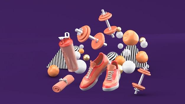 Manubri, scarpe da corsa, asciugamano arancione tra le palline colorate sul viola. rendering 3d