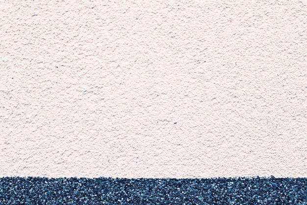 Struttura della parete dello stucco a due tonalità come primo piano del dettaglio del grunge