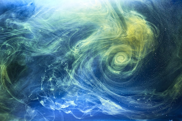 La terra colora lo sfondo astratto, la vernice colorata di fumo sott'acqua, l'inchiostro vorticoso nell'acqua, l'oceano blu del mare dell'esopianeta