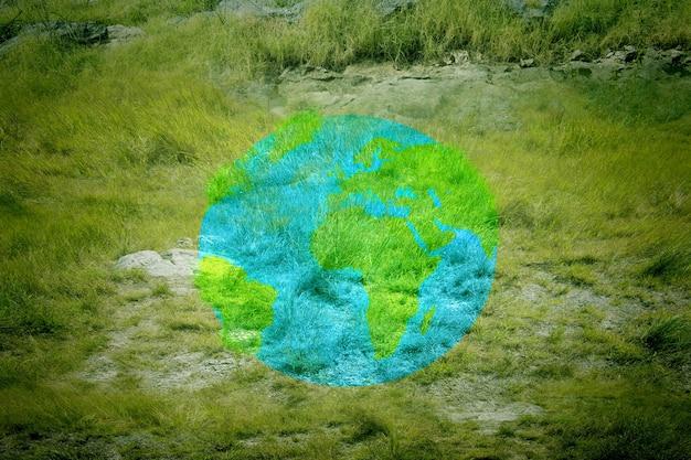 Modello di terra sul campo di erba verde. giornata mondiale per l'ambiente
