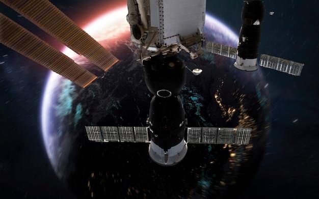 Pianeta terra e iss, fantastico sfondo di fantascienza. elementi di questa immagine forniti dalla nasa