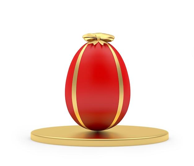 Uovo di pasqua su supporto rotondo dorato