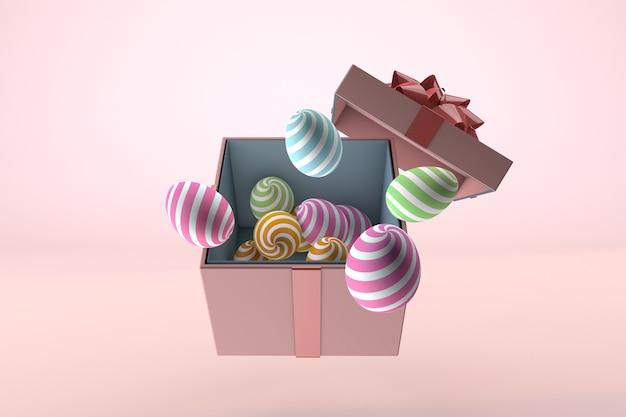 Uova di pasqua e confezione regalo su un pastello rosa