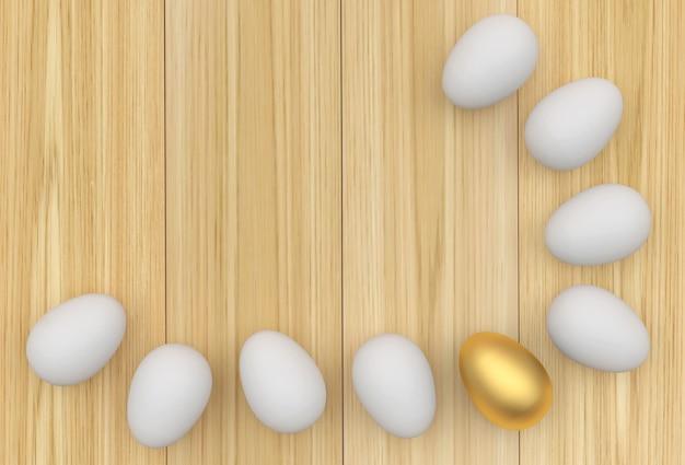 Uova con un uovo di pasqua dorato su legno