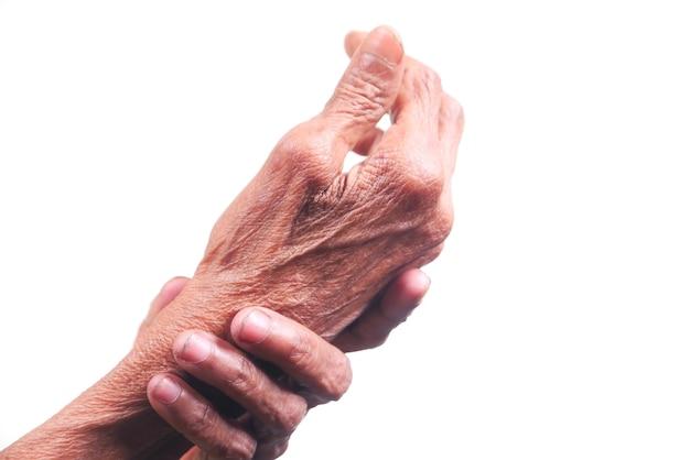 Donna anziana che soffre di dolore isolato su bianco.
