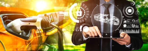 Concetto di realtà virtuale per auto elettriche con stazione di ricarica per veicoli elettrici per energia verde ed energia ecologica prodotta da una fonte sostenibile da fornire alla stazione di ricarica al fine di ridurre le emissioni di co2.