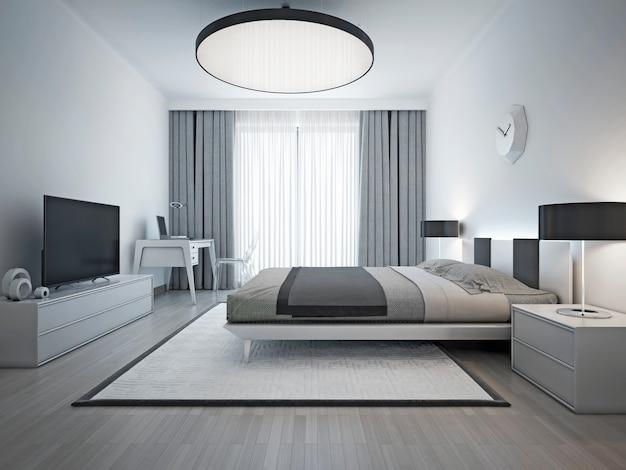 Elegante camera da letto in stile contemporaneo in camera da letto interna monocromatica con elegante letto matrimoniale e moquette bianca con cornice nera.