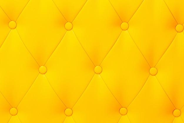 Elegante struttura in pelle gialla lucida saturata della poltrona.