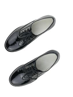 Eleganti scarpe da donna con lacci isolati su superficie bianca. scarpe da scuola alla moda. lay piatto.