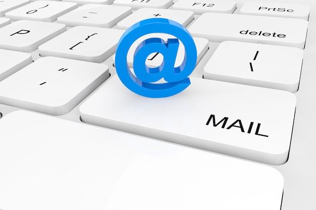 Concetto di posta elettronica. primo piano estremo segno di posta elettronica su una tastiera