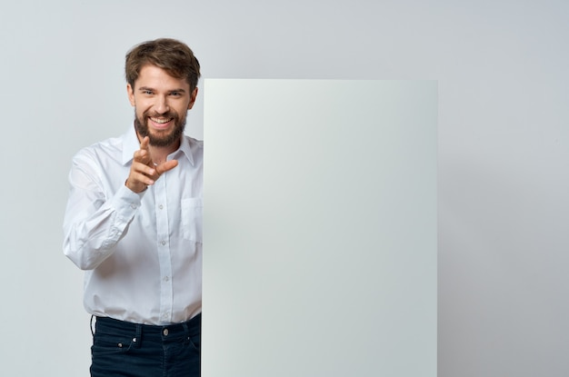 Emotional business man in shirt hold banner copy space presentation