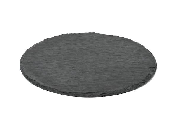Bordo di grafite rotondo nero vuoto per servire piatti isolati su sfondo bianco, vista dall'alto