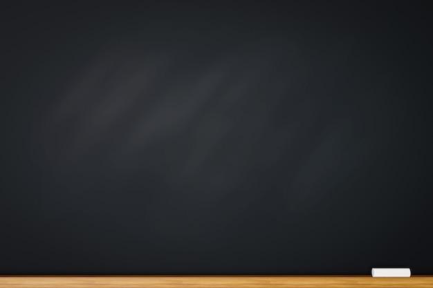 Lavagna vuota o sfondo nero con gesso
