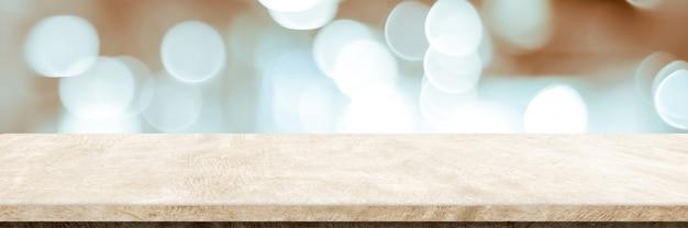 Tavolo vuoto in cemento marrone sopra il montaggio dell'esposizione del prodotto sullo sfondo del negozio di sfocatura
