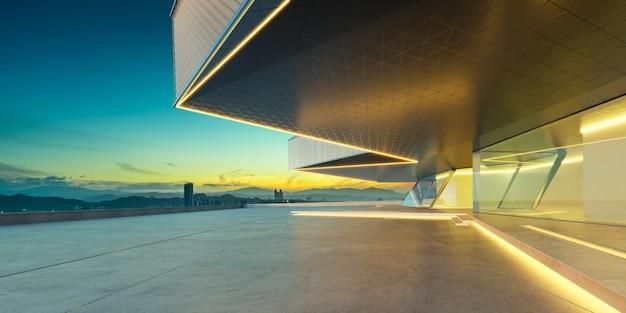 Pavimento vuoto del cemento con il fondo di paesaggio urbano esterno dell'edificio moderno