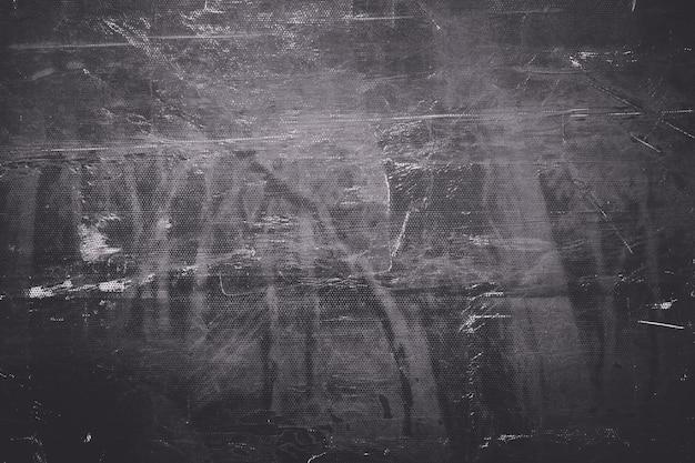 Struttura variopinta vuota di lerciume, fondo astratto. mezzitoni scuri e profondi colori lunatici