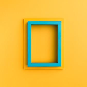 Cornici vuote su sfondo arancione Foto Premium