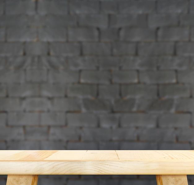 Svuoti la tavola di legno leggera e offuschi il muro di mattoni nero nel fondo, deridi sul modello per esposizione del vostro prodotto