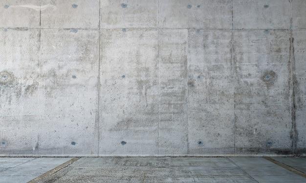 Il soggiorno moderno vuoto e la decorazione dei mobili e il muro di cemento sullo sfondo
