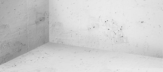Vecchia stanza vuota con sfondi di pavimento e muro di cemento