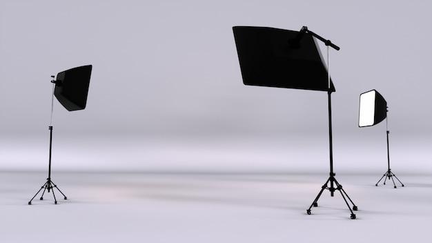 Studio fotografico vuoto con apparecchi di illuminazione. studio fotografico con riflettore flash e softbox. rendering 3d.