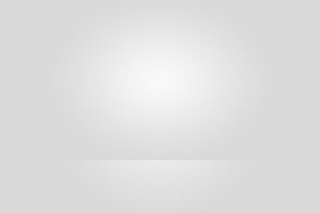 Fondo vuoto dello studio del fotografo estratto, struttura del fondo di bellezza blu chiaro scuro e chiaro, grigio freddo, parete piana e pavimento di gradiente bianco nevoso.