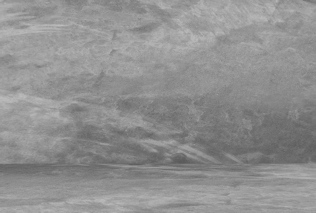 Stanza vuota con muro di cemento, sfondo grigio.