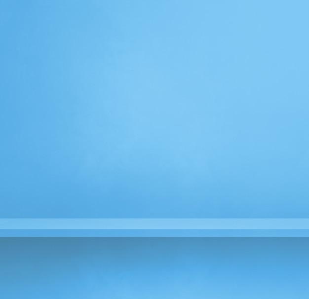 Scaffale vuoto su una parete blu. scena del modello di sfondo. banner quadrato