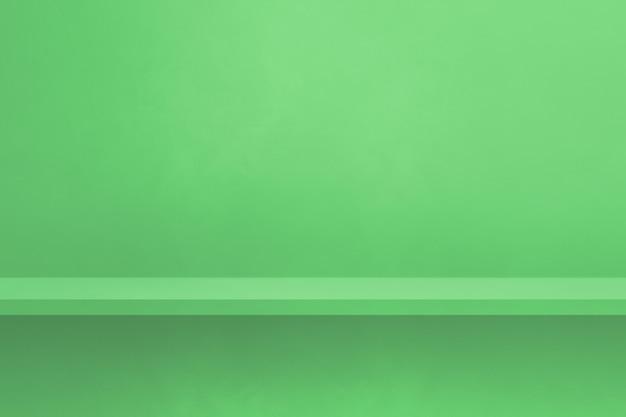 Scaffale vuoto su una parete verde. scena del modello di sfondo. sfondo orizzontale