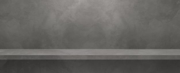Scaffale vuoto su un muro grigio. scena del modello di sfondo. banner orizzontale