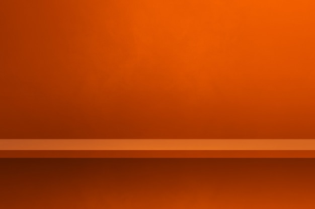 Scaffale vuoto sulla parete arancione. scena del modello di sfondo. sfondo orizzontale